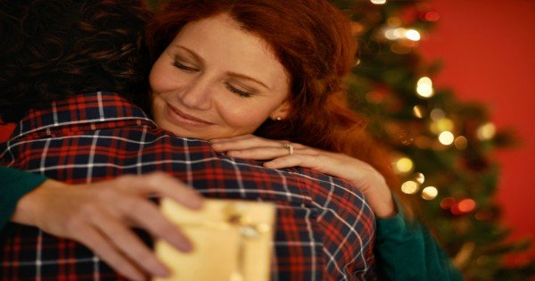 Shot of a young woman embracing her boyfriend after receiving a gift from him