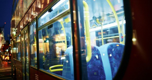 London double-decker bus returning to bus parking