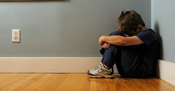 sad boy in room istock