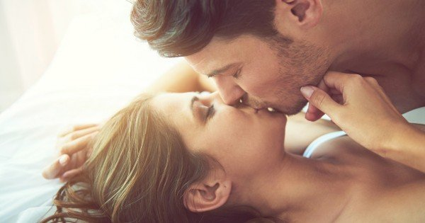couple kissing in bed via istock