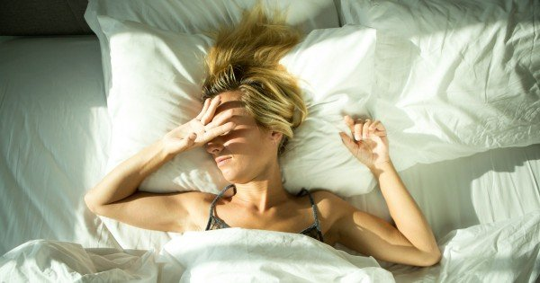 sunlight on woman in bed image via istock