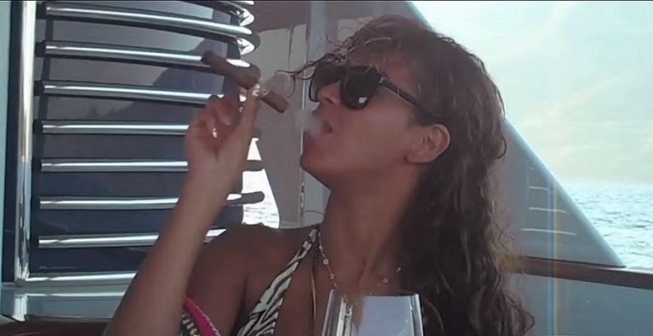 Beyoncé smoking a cigar