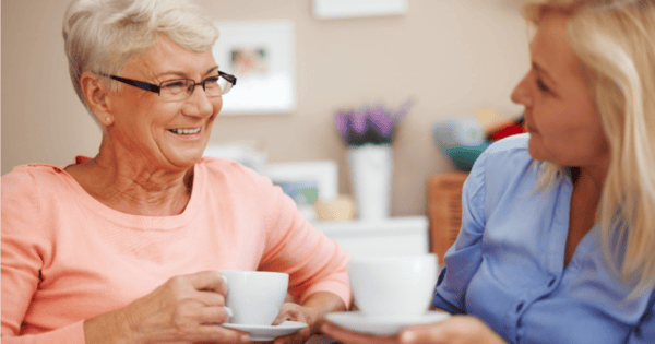 Retired lady having tea with her friend.