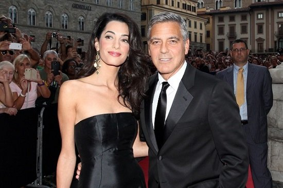 Amal gives the crowd a sexy side eye while George is his usual silver fox level of handsome