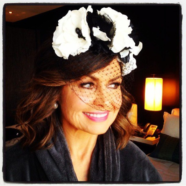 Lisa Wilkinson getting races-ready by paring hat and bathrobe.