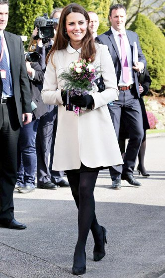 Kate Middleton in a cream-coloured coat at Clare Charity Centre in Saunderton, Buckinghamshire, England.
