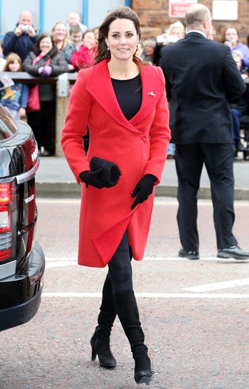 Kate Middleton stunning in a bright red Versace coat.