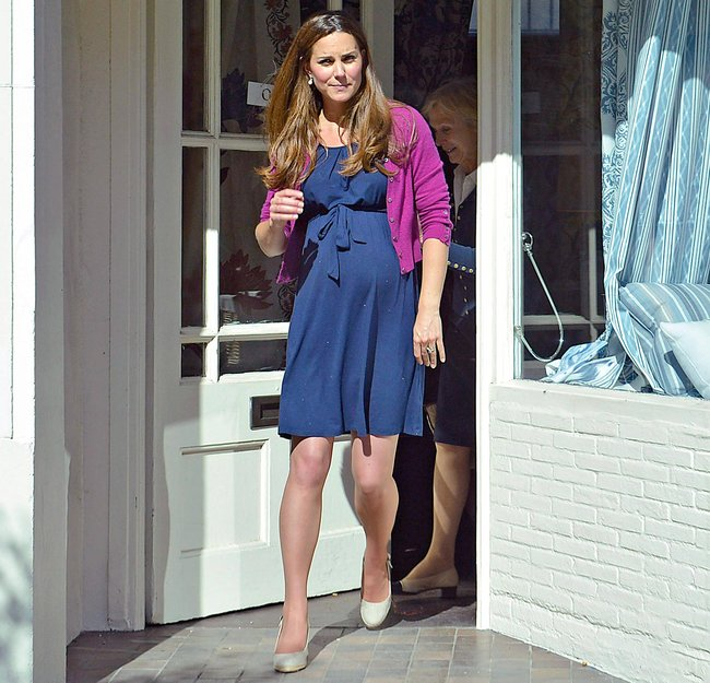 Kate Middleton wearing a $30 ASOS wrap dress while shopping for nursery furniture in Chelsea, London.