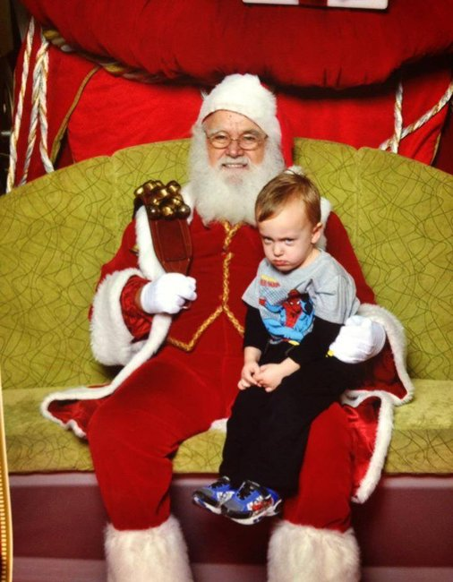 Oh, my goodness. Let that child get off Santa. Too much unhappiness for Christmas.