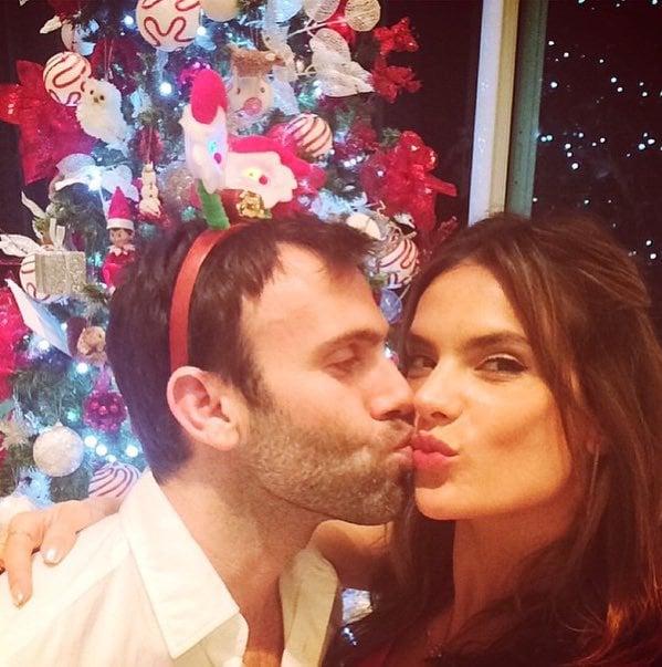 Alessandra Ambrosio got a kiss under the mistletoe.