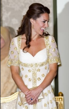 The Duchess looking royal in a white gown by Alexander McQueen.