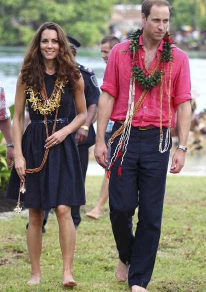 Kate in a navy blue Mulberry frock as she arrives in the tiny village of Marau on the Solomon Islands.
