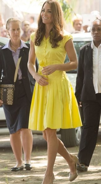 In a yellow Jaeger dress.
