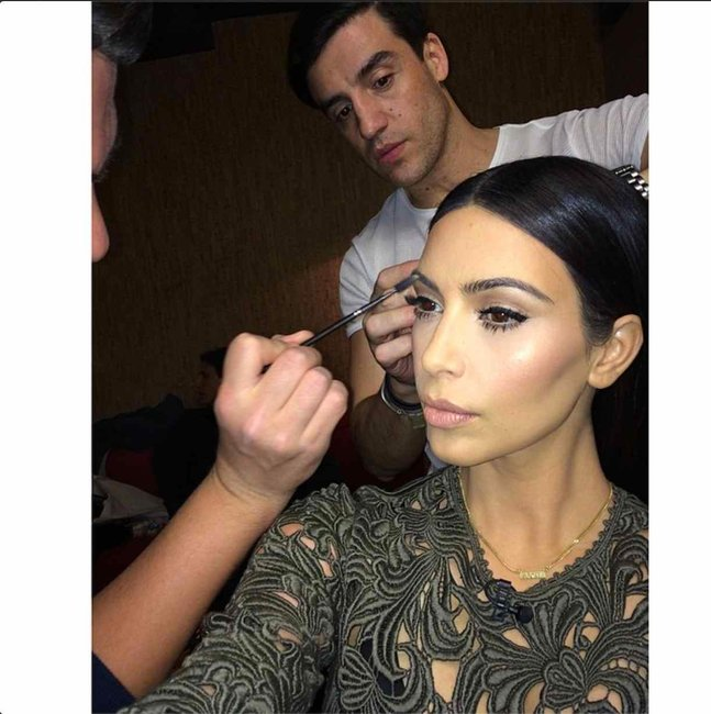 Kimmy getting all dolled up for a talk show interview.
