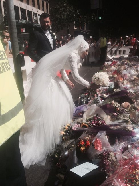 A muslim bride places flowers at Martin Place
