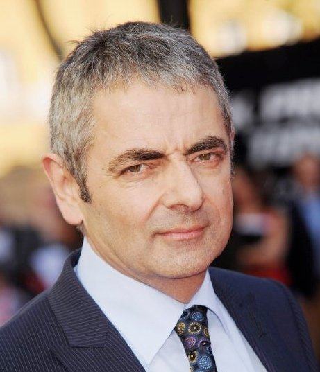 Rowan Atkinson, who played the shop assistant, now. Image via IMDb/Getty.