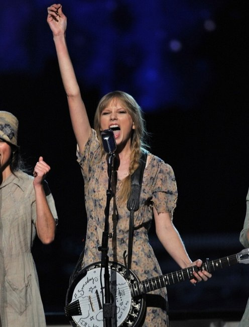 Taylor Swift performing onstage at the 2012 Grammys