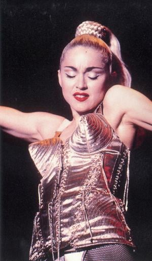 Madonna wearing the famous cone bra costume designed by Jean-Paul Gaultier.
