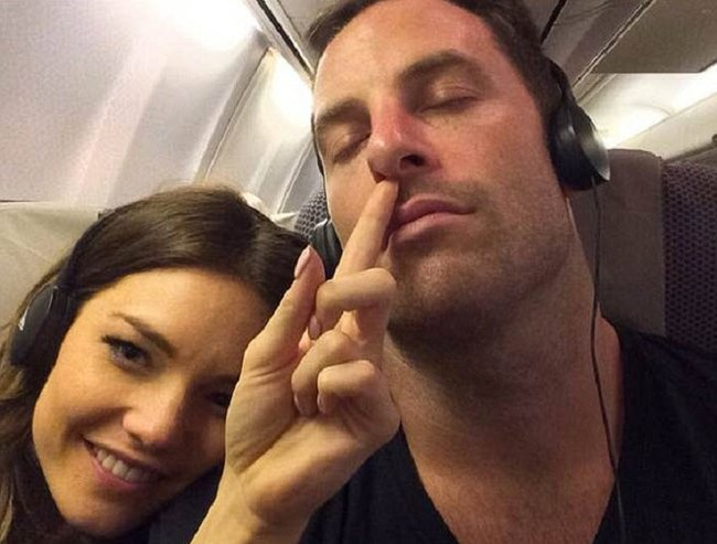Sam and her boyfriend Sasha Mielczarek playing around on a plane.