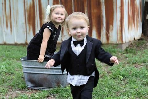 Boy in suit with girl in dress