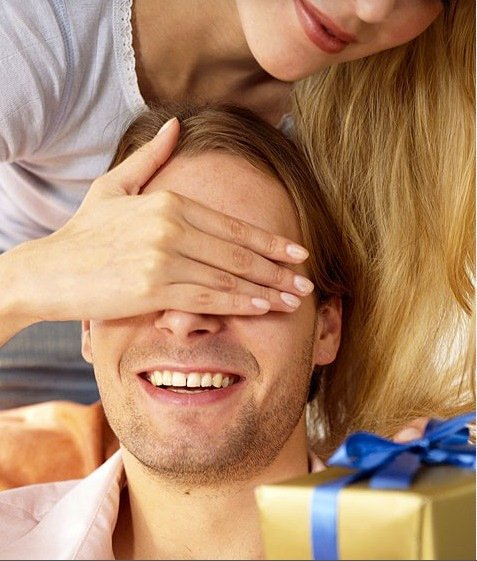 woman covers husbands eyes and tries to surprise him