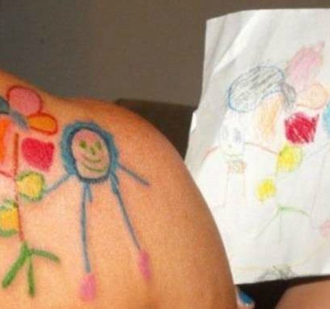 child drawing tattoos