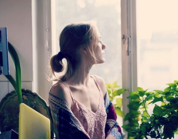 woman-looking-out-window