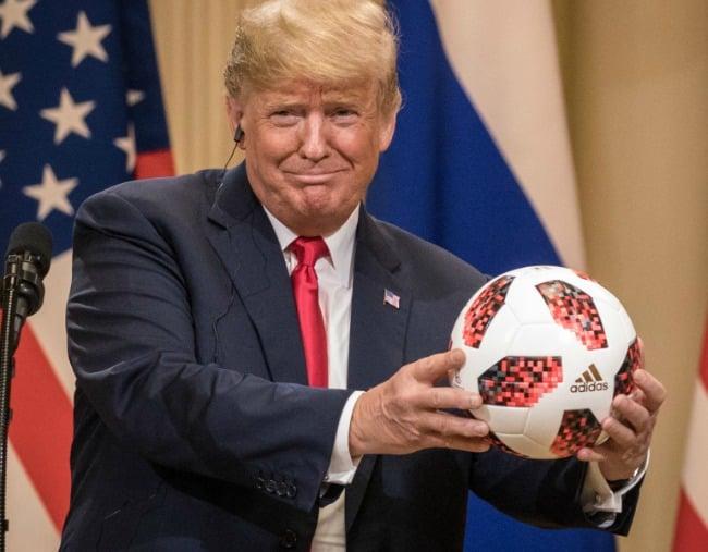 donald trump just threw a soccer ball at melania in public