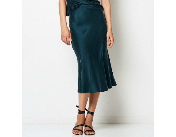 8487aaefd3a2 Everybody will be wearing this silk midi skirt this summer. Shop one ...