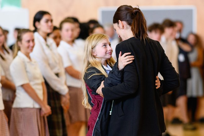 Cashmere High School student receives a hug from Prime Minister Jacinda Ardern