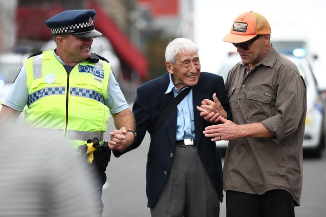 Auckland policeman Rob, John Sato and actor Bruce Hopkins walk the Love Aotearoa Hate Racism march