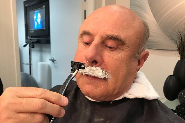 Dr Phil has shaved his moustache and it is not okay