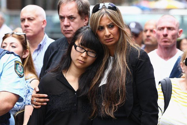 Victims Fiona Ma and Selina Win Pe at site of Sydney Siege in the week following. Image via Getty.