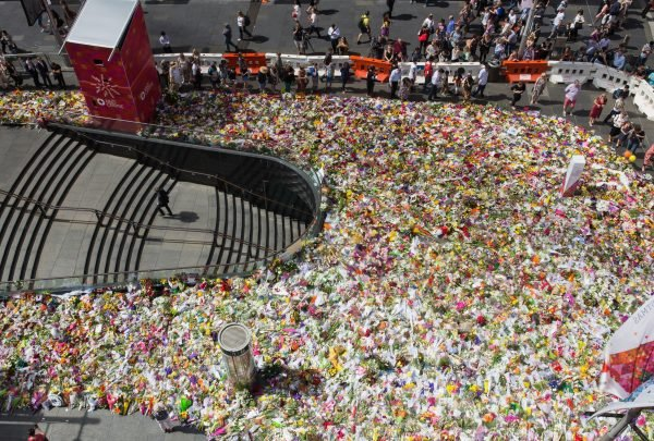 Sydney paid respect to the victims of the Lindt Cafe Siege by leaving flowers in Martin Place. Image via Getty.