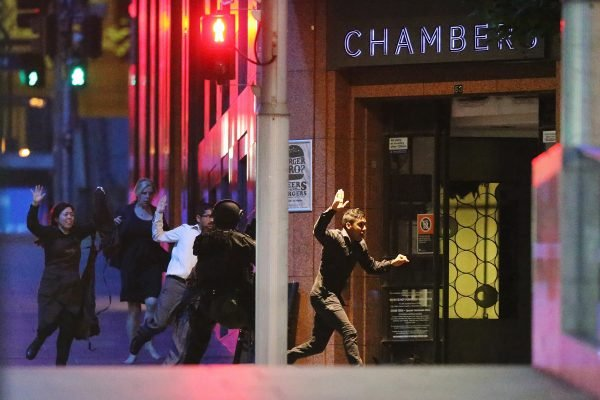 Hostages escape from Lindt Cafe. Image via Getty.