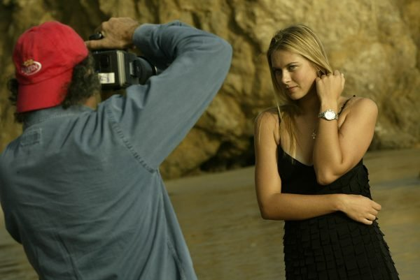 Patrick Demarchelier (left) photographs Maria Sharpova for a TAG Heuer watch ad on a Malibu Beach. F